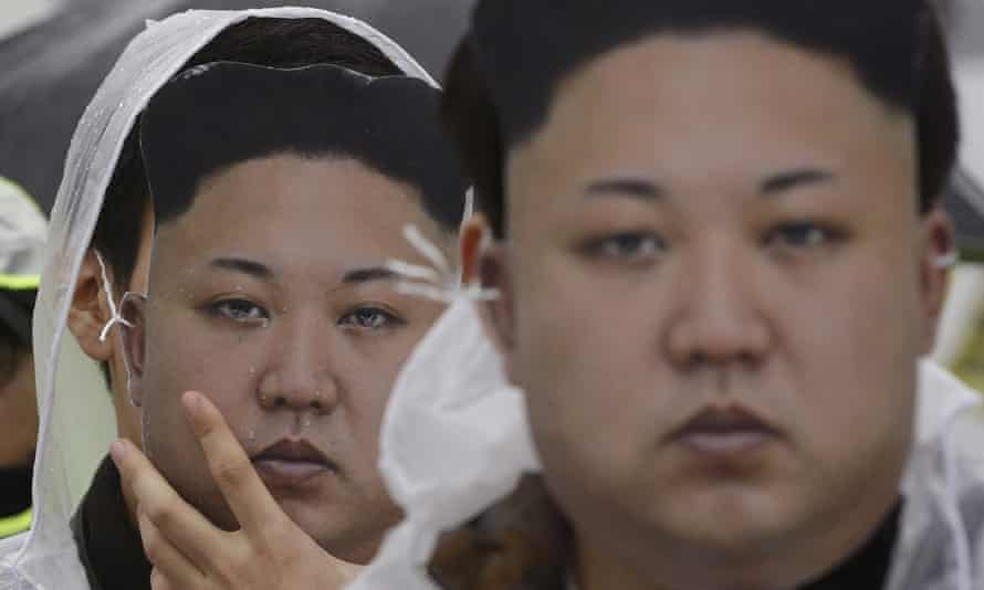 North Korean defectors in Kim Jong-un mask at a protest rally in Seoul. Dzhon changed his identity when he arrived in the South
