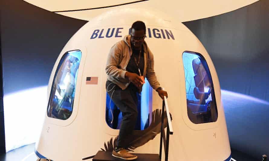 A participant leaves the Blue Origin space simulator in Las Vegas, Nevada