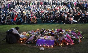 Crowds gather for a vigil being held on the site of the alleged rape and murder of Eurydice Dixon in Princes Park, Melbourne.