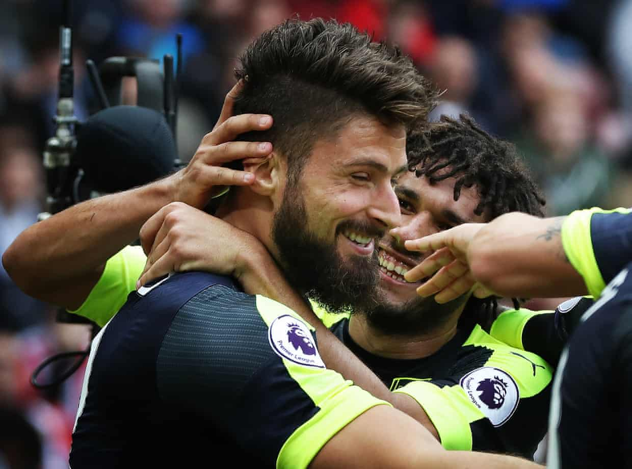 Oliver Giroud celebrates after he scores his second goal and Arsenal's third.