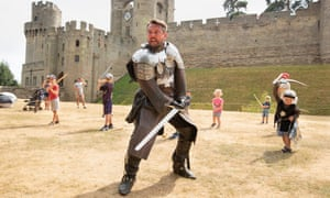 Christopher Hampson teaching young visitors the art of swordplay at Warwick Castle.