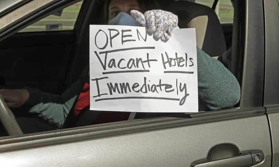An activist protests from her vehicle outside Moscone Center, asking Mayor London Breed to house homeless people using vacant hotels.