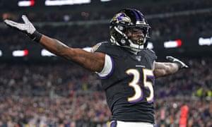 Baltimore Ravens running back Gus Edwards celebrates his second-quarter touchdown
