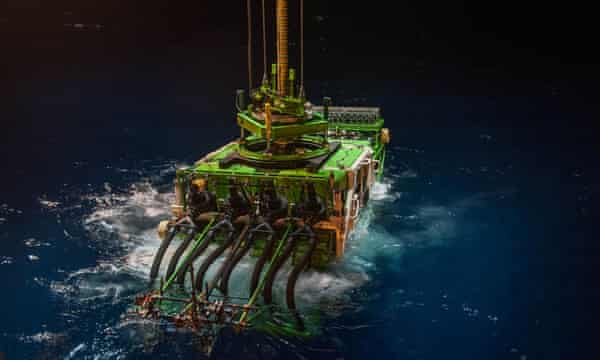 A deep-sea mining robot being lowered into the Pacific Ocean's Clarion Clipperton zone for trials.