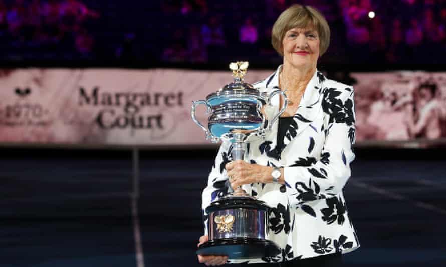 Margaret Court lifts a replica Daphne Akhurst trophy on Rod Laver Arena