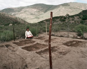 Anna Boois, goat farmer, with her birthday cake and vegetable garden, Kamiesberge, near Garies, Namaqualand, Northern Cape, 20 September 2003.