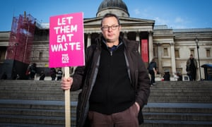 Hugh Fearnley-Whittingstall with a let them eat waste placard