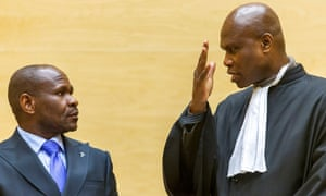 Mathieu Ngudjolo Chui, left, a former Congolese militia leader, at his trial at the international criminal court in The Hague.
