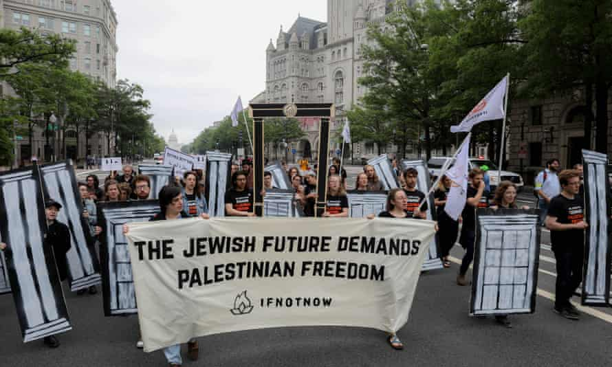 Demonstrators march towards Trump Hotel in Washington on Monday to protest against the relocation of the US embassy from Tel Aviv to Jerusalem.