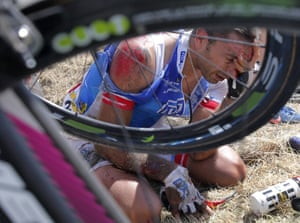 <strong>Stage Three</strong><br>Stage location: Antwerp to Huy, Netherlands<br>Stage Winner: Joaquim Rodriguez<br>William Bonnet of France holds his head after crashing with several other riders, forcing him to abandon the race