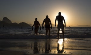 People enter the water for a morning swim on Copacabana beach. AP tests have indicated tourists could face serious health risks at the famous destination