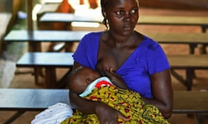 A mother breastfeeds her child in Freetown, Sierra Leone