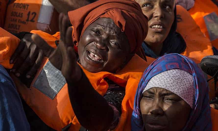 Migrants aboard a dinghy off the Libyan coast
