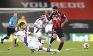 Crystal Palace's Gary Cahill, left, catches Bournemouth's Joshua King after winning the ball.