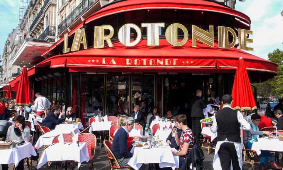 Red canopy of Restaurant La Rotonde on a street corner, Paris