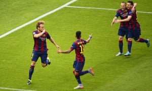 Rakitic, left, celebrates with his team-mates.