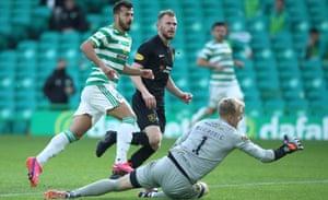 Albian Ajeti scores what proved to be Celtic's winner past Livingston's Robbie McCrorie