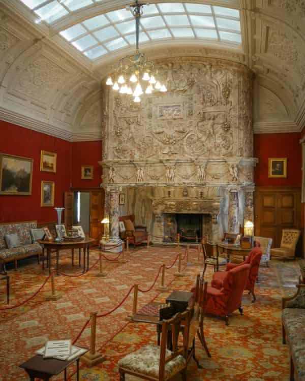 Huge fireplace dominating drawing room