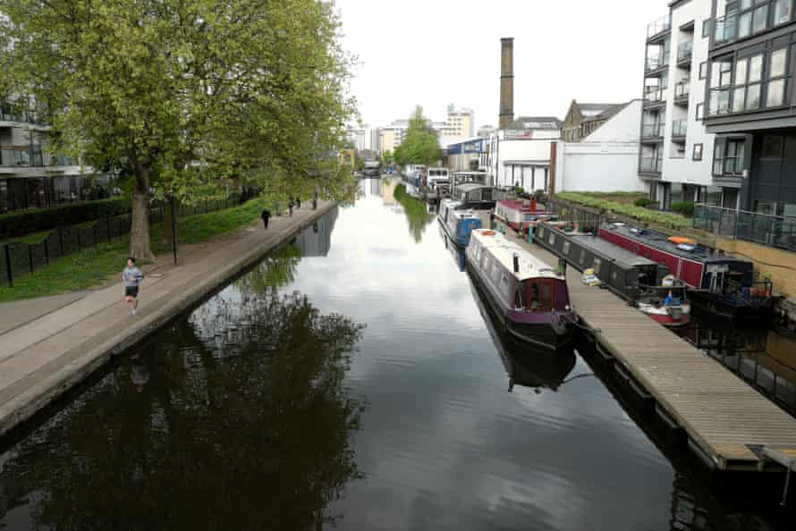 A view of Regents Canal and boats towards Sturts Lock near Sherpherdess Walk and City Road Islington London N1