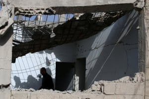 Deraa, Syria A man inspects a damaged house after air strikes yesterday in the rebel-held town of Dael