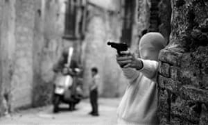 'People were afraid even to look at my photographs' … child with a gun in Palermo, 1982, which appears in Shooting the Mafia.