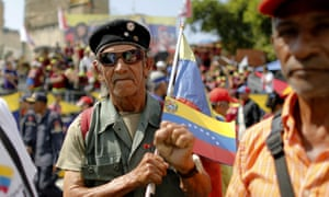 A supporter of Venezuela's president Nicolás Maduro outside the Supreme Court where he is sworn-in for a second term.