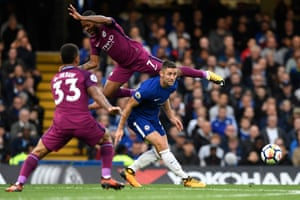 Chelsea's Gary Cahill retains posession and misses the challenge from Manchester City's Raheem Sterling as City move to the top of the Premier League with a 1-0 win at Stamford Bridge.