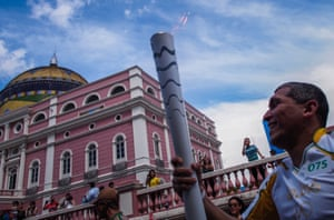 Euler Ribeiro Filho carries the Olympic torch in Manaus, Brazil.