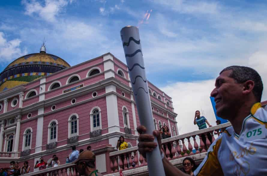 Euler Ribeiro Filho carries the Olympic torch in Manaus, Brazil