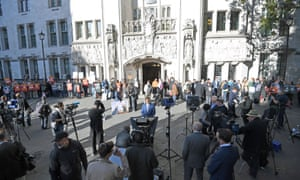 The media and protesters outside the supreme court, which is just off Parliament Square in London, facing the Houses of Parliament on the other side.