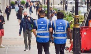 Covid marshals in London.