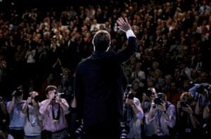 David Cameron waves to delegates