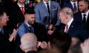 Jose Altuve, one of the best Latino players in the major leagues, greets Donald Trump at a White House reception for the champion Houston Astros
