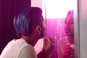 Dani Weber in drag as Dani Boi, applying facial hair