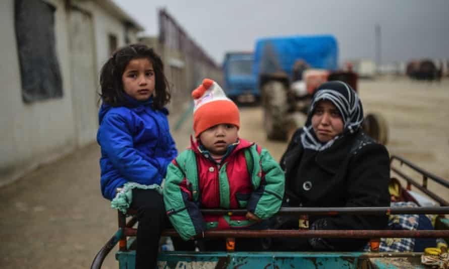Syrian refugee children arrive at the Bab al-Salameh border crossing into Turkey near the embattled northern city of Aleppo.