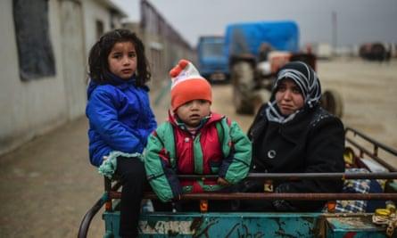 Refugee children arrive in a cart in Bab-Al Salam, near Azaz, northern Syria.