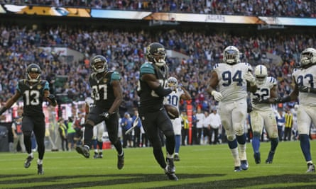 Allen Hurns, centre, celebrates after scoring a touchdown for Jacksonville Jaguars in their 30-27 win over Indianapolis Colts at Wembley