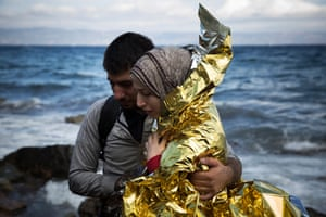 A Syrian couple hug after arriving on the Greek island of Lesbos.