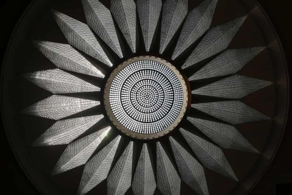 A crystal chandelier hangs beneath a nineteen meter dome