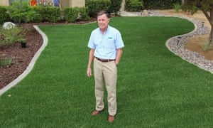 Norm Lopez, a sales rep for Southland Sod Farms, on the lawn of one of his clients.