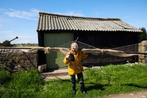 Margaret Owen stands on grass verge in the sunshine