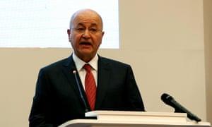Iraq's president, Barham Salih, attends a forum in Baghdad