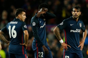 Atlético's Angel Correa, Teye Thomas and Augusto Fernandez look dejected after the final whistle.