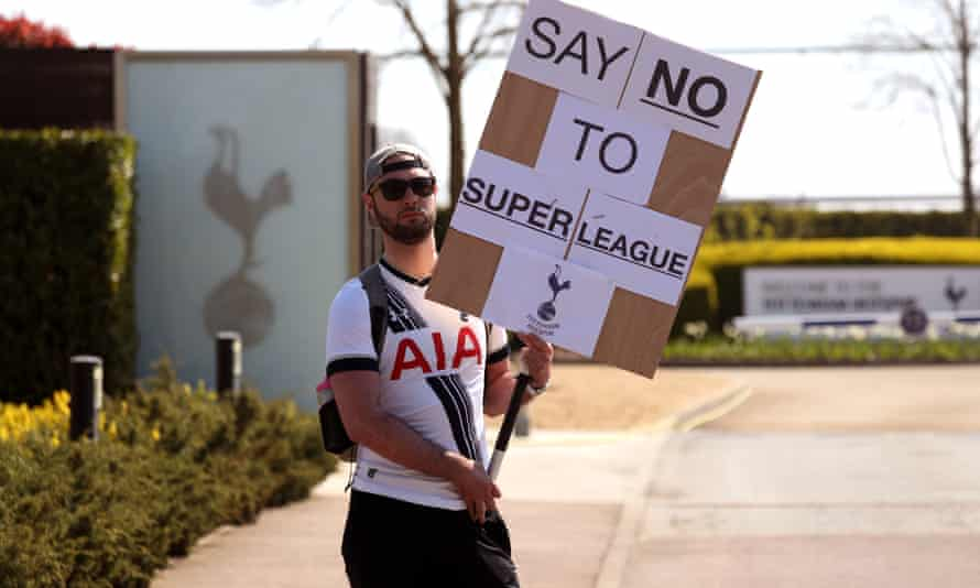 A Tottenham fan protests against the European Super League