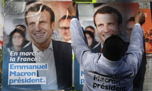 A supporter puts up posters for Emmanuel Macron in Rennes before the first-round vote.