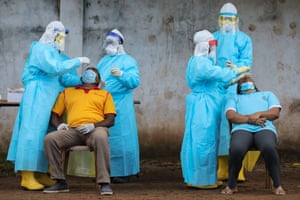 People undergo Covid-19 swab tests at an area under lockdown in Colombo, Sri Lanka