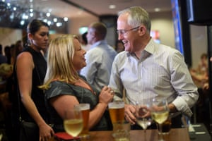 Turnbull has a beer with Liberal member for Solomon Natasha Griggs at a politics in the pub event in Darwin