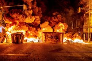 A burning skip forms a barricade across a street in Barcelona