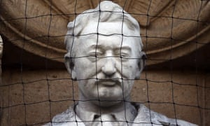 Sir Cecil Rhodes statue behind a protective net