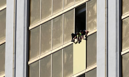 Workers board up a broken window at the Mandalay Bay hotel in Las VegasWorkers board up a broken window at the Mandalay Bay hotel, where shooter Stephen Paddock conducted his mass shooting along the Las Vegas Strip.